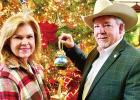 Representative Keith and Annette Bell Place Athens-Inspired Ornament on Capitol Christmas Tree